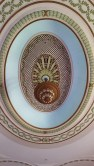 This is the oval medallion seen on the ceiling of the auditorium.