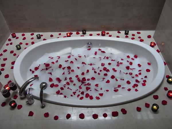 Bath with petals surrounding it