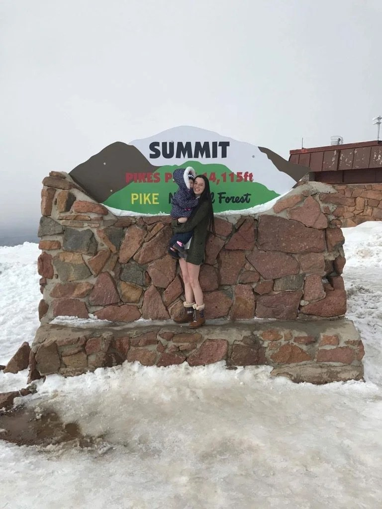 Mom is traveling with her toddler to Pikes Peak, Colorado