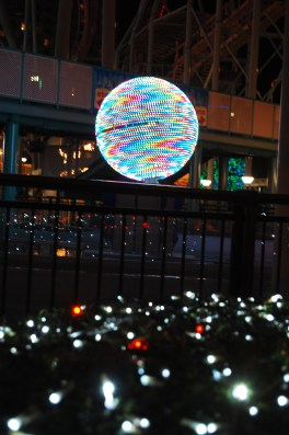 Colourful glowing ball in front of the ferriswheel