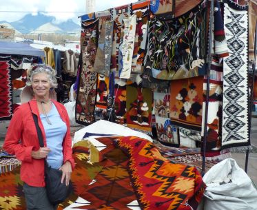 Colorful rugs and shawls available at the Otavalo market.