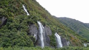 Waterfalls into the Franz Josef Glacier valley