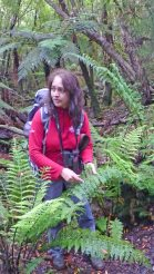 Furhana from Ruggedy Range on Stewart Island describing facts about ferns during tour of Ulva Island
