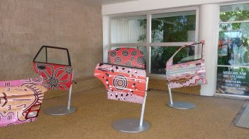 Aboriginal art designs painted on car-doors at Darwin Museum and Art gallery