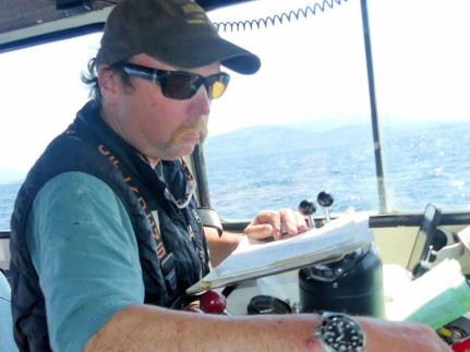 Captian Daniel completing the paperwork for our halibut catch