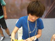 Zeng Yike signing autographs.
