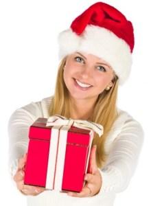 woman-giving-chirstmas-gift-with-santa-hat