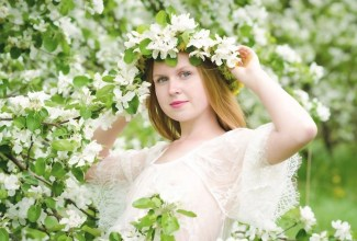 woman spring flowers with white flower wreath