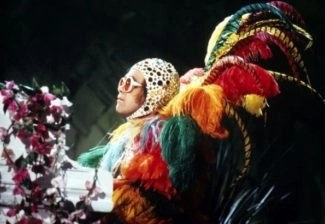 rockeman elton john with feathers and headdress
