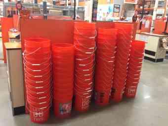 5 gallon buckets displayed at Home Depot**