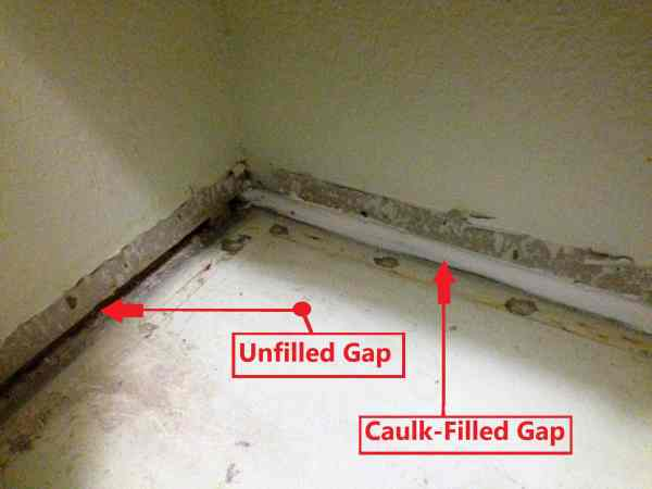 Caulked gap at floor for sound proofing