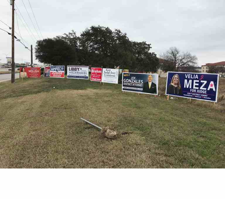 Political signs neatly along roadway, no cost for space for the politicians.