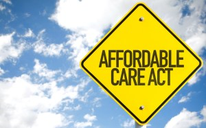 Affordable Care Act sign with sky background