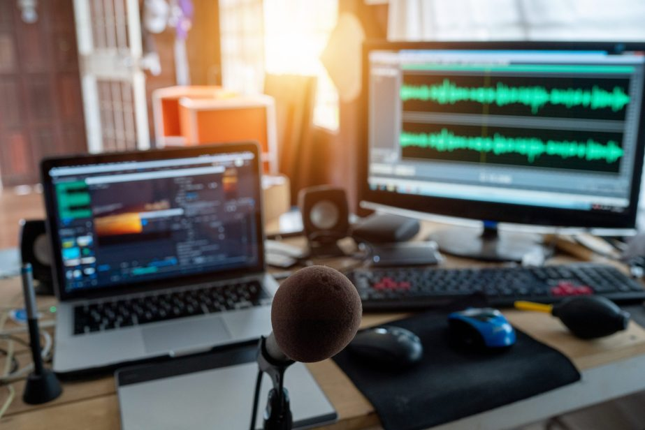 The content creator sound waves monitor preview and editing video footage in the freelance house studio