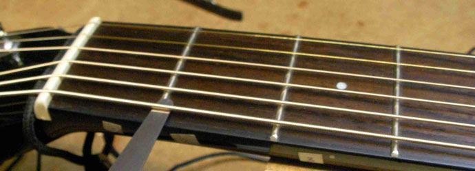 Bridge Lowering Acoustic Guitar