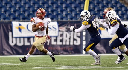 Kevin Brown of Everett runs the ball as he is trailed by Trevor Carroll of Xaverian their 35-10 MIAA Div. 1 Super Bowl win at Gillette Stadium, Saturday, Dec. 2, 2017.