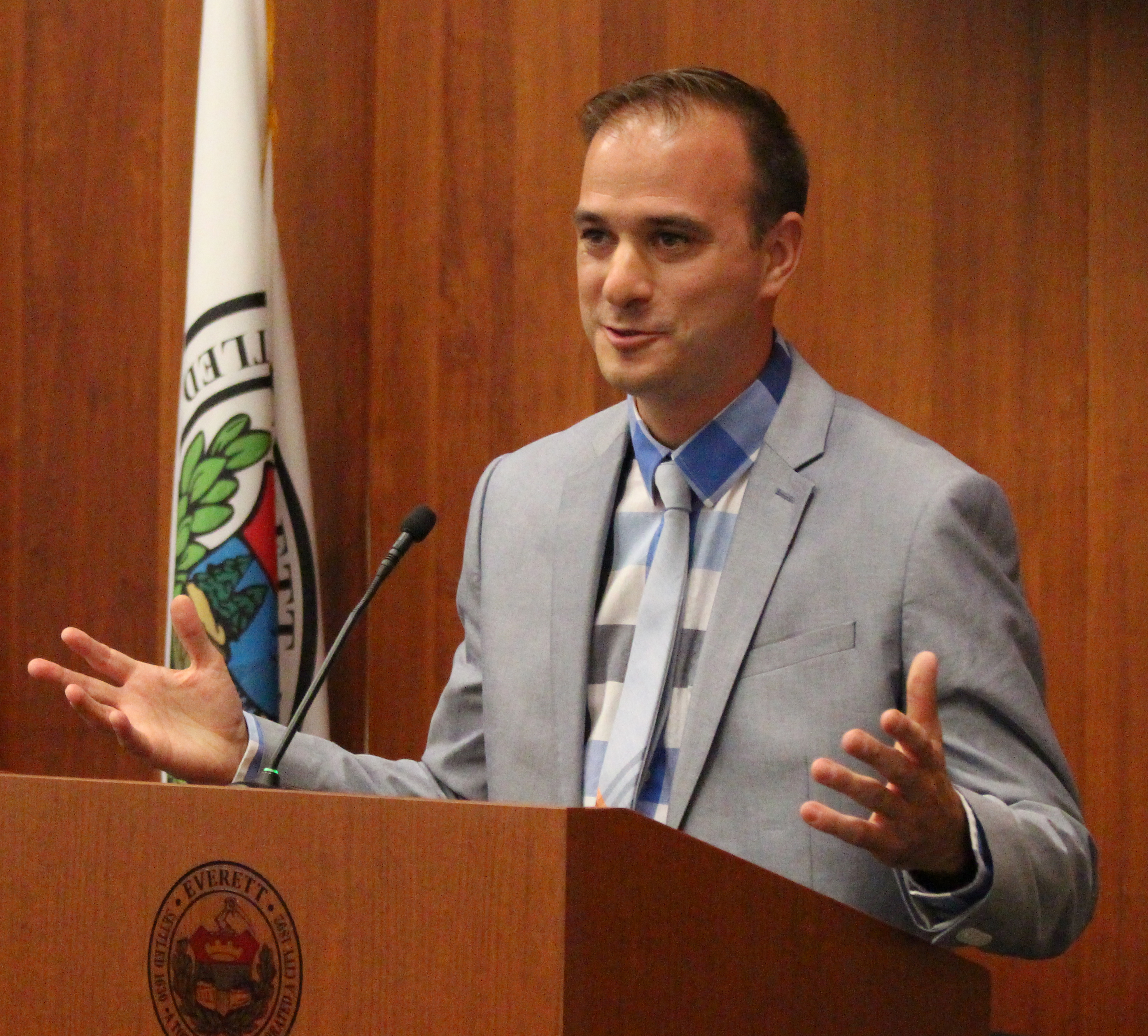 "Sergio Cornelio addresses the City Council shortly after being sworn-in as City Clerk. --- Longtime City Clerk and 40-year public servant Michael Matarazzo – known throughout City Hall as the ""Everett Historian"" – retired on June 28. Reflecting on his tenure, Matarazzo is proud to have stayed ""above the fray"" during his tenure, maintaining the City Clerk's Office's neutrality in the midst of Everett's sometimes hardball politics. ""I'm fortunate. I've had good relationships with all the mayors. I was able to serve and not make other people's enemies my enemies. I was able to stay above that and bring that neutrality to the Clerk's Office – stay at arm's length from all the personal and political fights, which is what people want from the position. That's something I'm really proud to have been able to have done."" His Assistant Clerk, Sergio Cornelio, was appointed by the City Council as his successor on August 3. ""I promise to work harder and harder to be the best city clerk I can be,"" said Cornelio. ""I don't intend to be John Hanlon or Mike Matarazzo. I intend to be my own man, but I've learned from them."" On Monday, September 25, former Mayor David Ragucci was appointed Assistant City Clerk."
