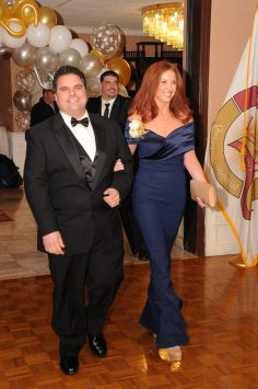 Maryor Carlo DeMaria enters the Inaugural Ball with his wife, Stacy.