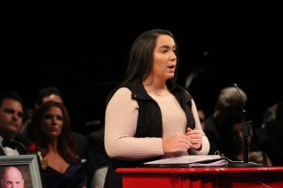 """EHS student Luiza Oliveira recites the poem """"Character"""" by Alfred Parlin."""