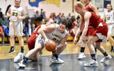Emory Caswell of Lynnfield gains control of a loose ball during their game against Masconomet at Lynnfield High School on Monday, Jan. 22, 2018.
