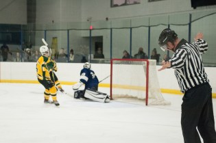 Aidan Kelly defends the net from a North Reading shot seconds before the game ends.