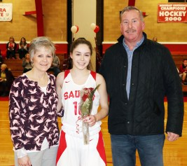 Meaghan Gannon with her parents, Michelle and Mark.