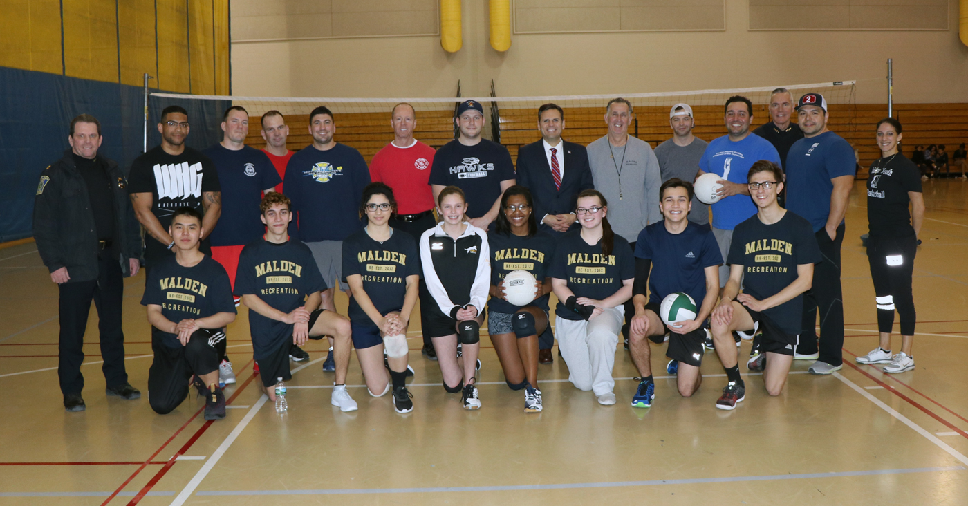 Mayor Gary Christenson, chiefs Kevin Finn and Kevin Molis and Director Joe Levine with the MHS varsity volleyball players and members of Malden's fire and police departments at Salemwood Gymnasium last Tuesday evening.