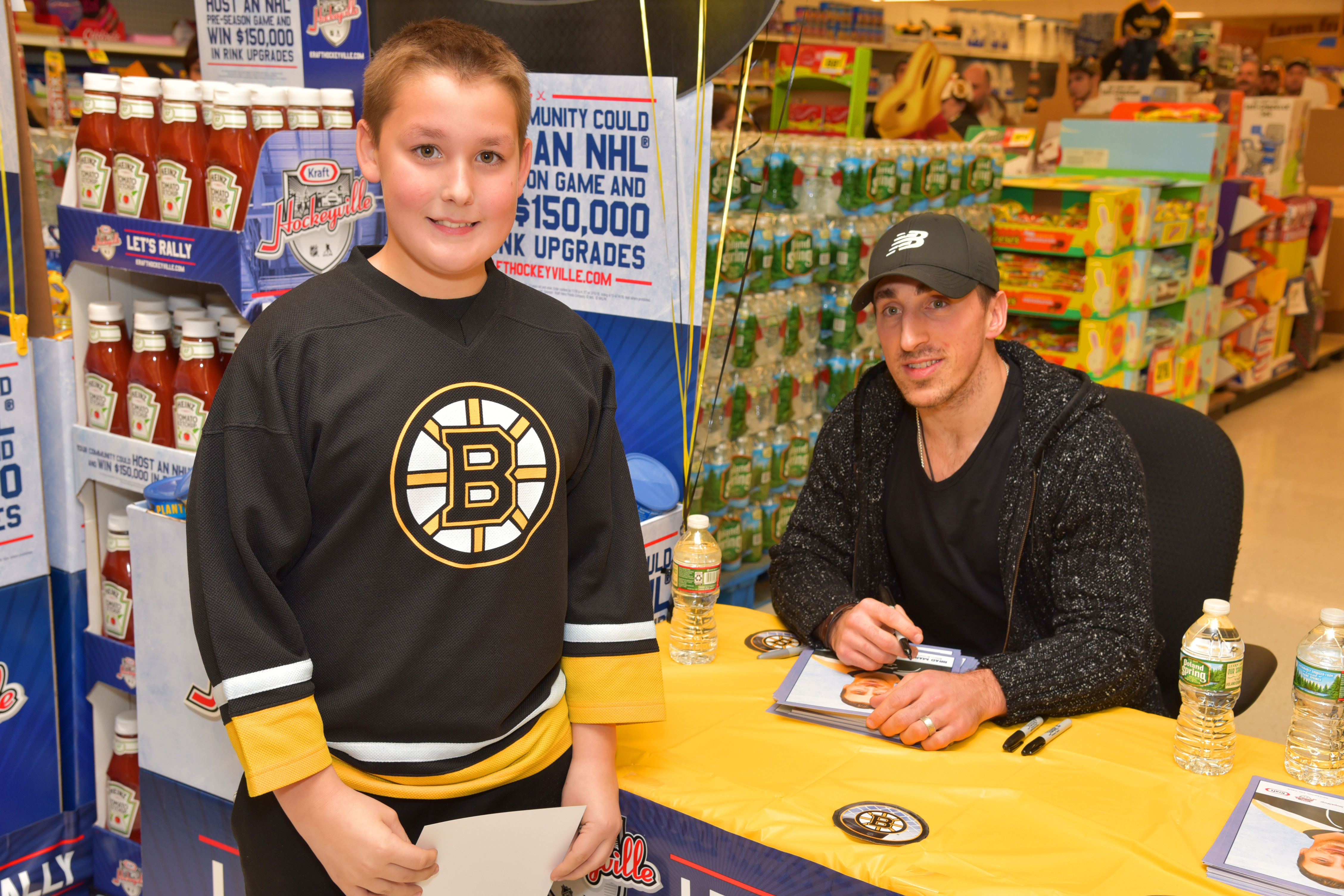 Matthew Lewis with Brad Marchand