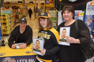 Brad Marchand with Julia and Elain Vajao