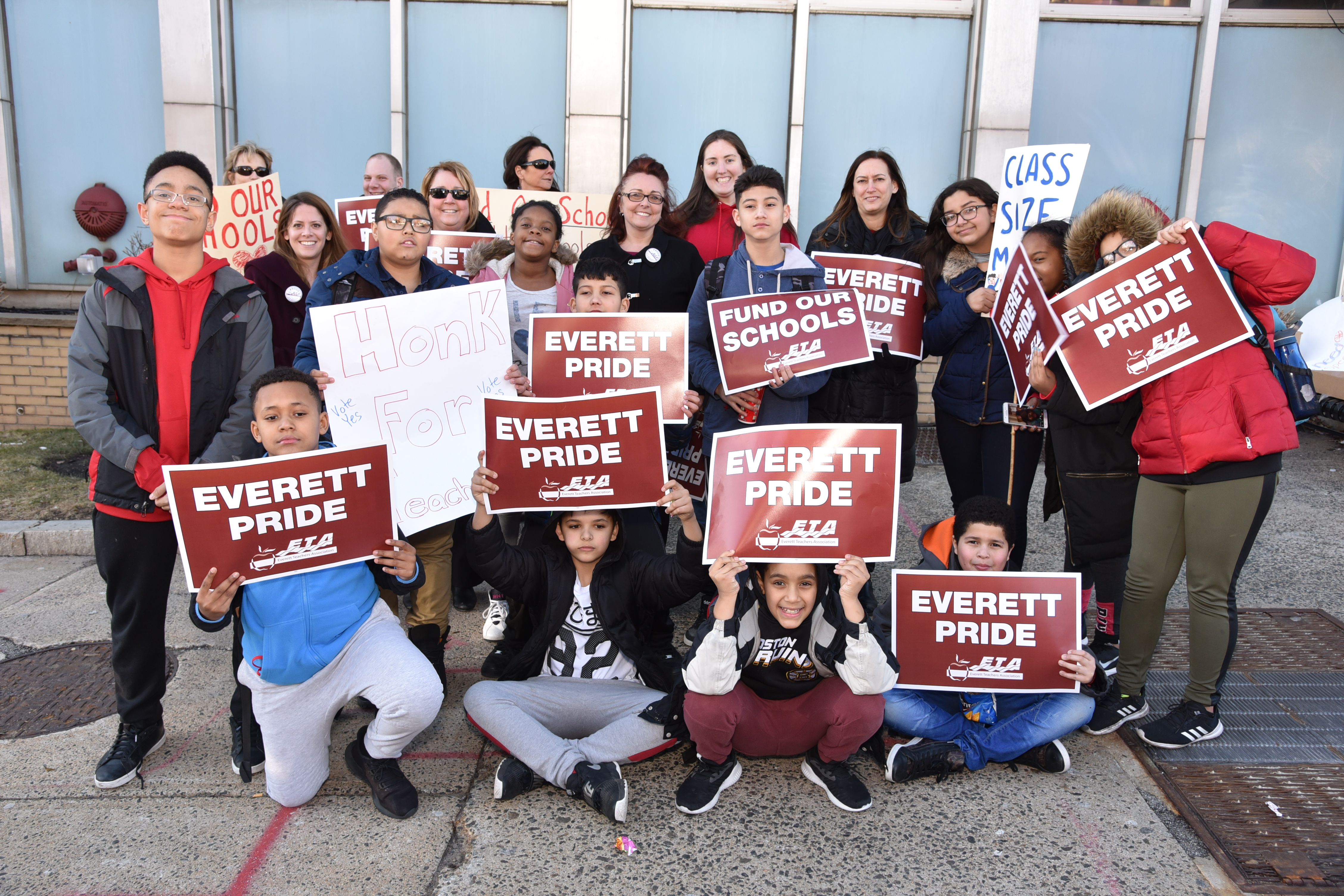 Everett Teachers' Association President Kim Auger is shown with students and teachers during a rally outside city hall Monday in support of the 110 school employees facing layoffs.