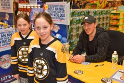 Melinda and Jeannette Rizzo with Brad Marchand