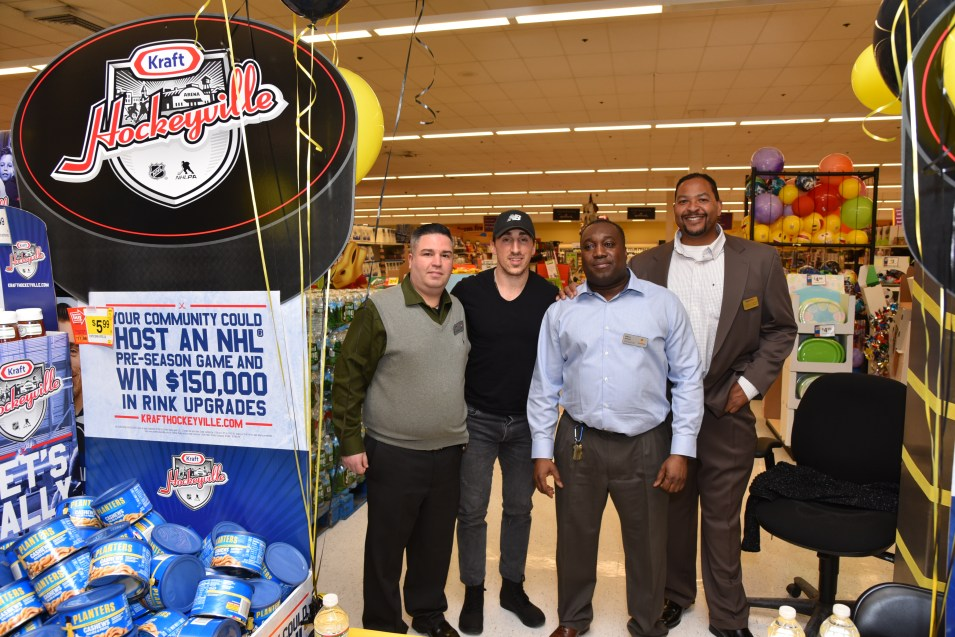 Asst. Manager Angelo Raffaele, Brad Marchand, Store Manager Wilbert Aubourg, and Kraft Customer Retail Manger Anthony Johnson