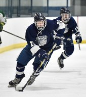 Chris Flannery of Lynnfield controls the puck during their game against Pentucket-Georgetown at the McVann-O'Keefe Rink in Peabody on Tuesday, Feb. 20, 2018.
