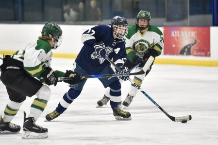 Kyle Nekoroski of Lynnfield takes a shot on goal during their game against Pentucket-Georgetown at the McVann-O'Keefe Rink in Peabody on Tuesday, Feb. 20, 2018.