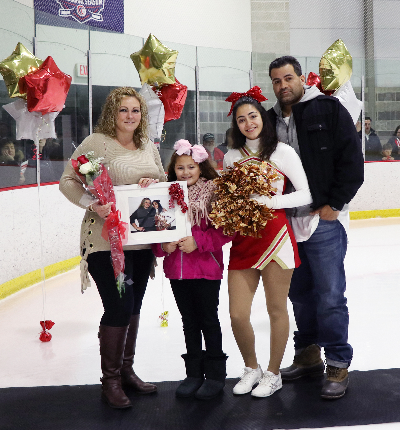 Victoria Arzola with her parents, Gina and Hector, and sister, Chloe