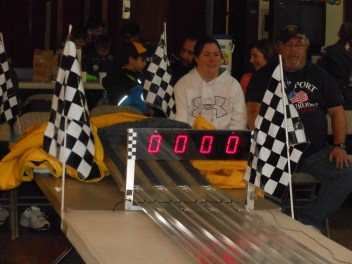 AT THE FINISH LINE: Fans got excited as they waited for the miniature wooden cars to pass the checkered flags at Saugus Cub Scout Pack 62's Annual Pinewood Derby.