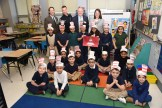 Garfield first graders and Garfield Principal Corbett Coutts, Officer John Cafarelli, Speaker of the House Robert DeLeo, and Meghan Oliphant