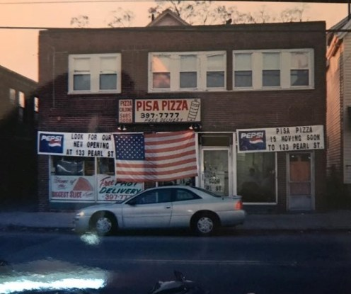 HUMBLE BEGINNINGS: In this photo taken around 2000 shows the first Pisa Pizza location at 258 Highland Ave. The banner announces their move to their new location on Pearl Street.