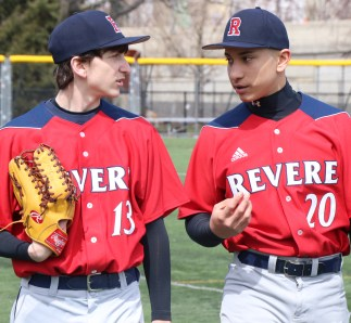 Joey Gendreau and Lucas Rincon talk things over before the game on last Saturday in East Boston.