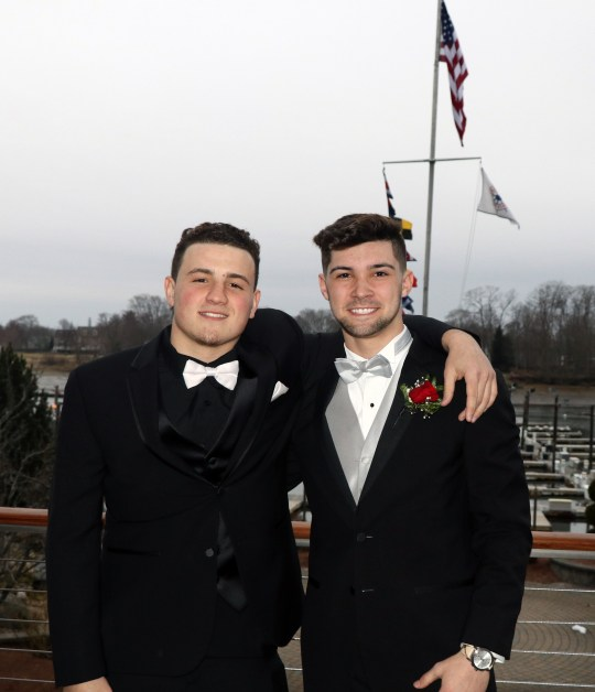Friend enjoying the outside deck waiting for their dates, Frank Simms and Jonathan Murphy.