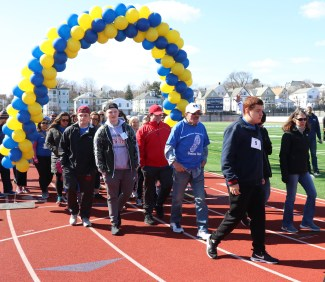 The large group of walkers head out for the 26 laps around the stadium.