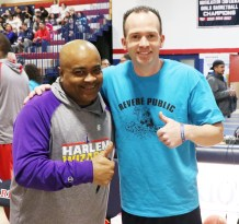 A- Train from the Harlem Wizards is shown with the RHS Basketball Head Coach and Schoolie David Leary.