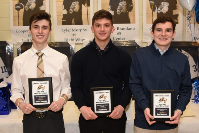 LHS 2017-2018 Varsity Boys Ice Hockey Pioneer Passion Award winner Robert Brandano, 2017-2018 Varsity Boys Ice Hockey Pioneer Work Ethic Award winner Tyler Murphy, and 2017-2018 Varsity Boys Ice Hockey Pioneer Selfless Award winner Kyle Nekoroski