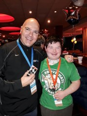 "ANOTHER BUDDY: Saugus's Bob Catinazzo stands with Christos Couturier of Dracut, one of the three ""patient partners"" from Boston Children's Hospital's Miles for Miracles program whom he will be dedicating his miles to in Monday's Boston Marathon. Catinazzo joins his young friend at a kickoff reception for Boston Children's Hospital. (Courtesy Photo to The Saugus Advocate)"