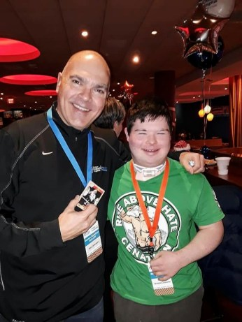 """ANOTHER BUDDY: Saugus's Bob Catinazzo stands with Christos Couturier of Dracut, one of the three """"patient partners"""" from Boston Children's Hospital's Miles for Miracles program whom he will be dedicating his miles to in Monday's Boston Marathon. Catinazzo joins his young friend at a kickoff reception for Boston Children's Hospital. (Courtesy Photo to The Saugus Advocate)"""