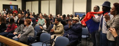 Members of the city's immigrant community and their supporters packed the council chambers at city hall Monday night.