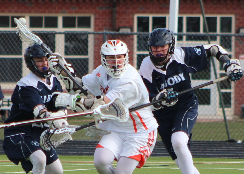 Peabody freshmen Nick Vecchio and Andrew Lucas converge on an Ipswich player in Tuesday's loss at Ipswich High School.