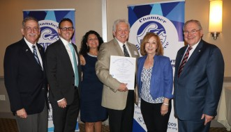 The Executive Director team of Bob and Marguerite Upton was recognized for their dedication and service to the Revere Chamber for many years, shown with the Uptons, Ward 2 Councillor Ira Novoselsky, Mayor Arrigo, Representative RoseLee Vincent and Speaker DeLeo.
