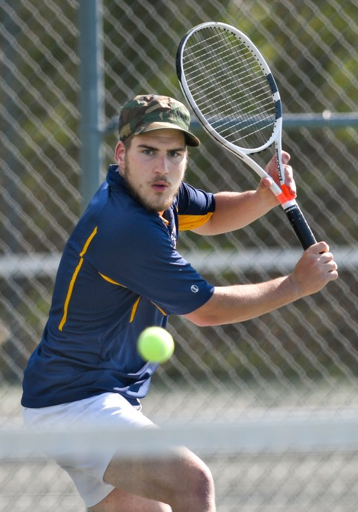 Lynnfield's third singles player Colin Lamusta keeps his eyes on the ball during their match against Ipswich at Ipswich High School on Monday, May 7, 2018.
