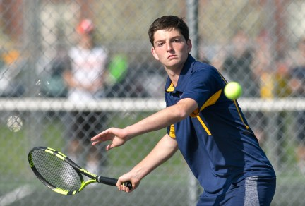 Lynnfield's first doubles player Michael Gentile prepares to make contact with the ball during their match against Ipswich at Ipswich High School on Monday, May 7, 2018.